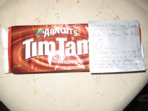 Tim Tam cookies with instructions on how to eat them